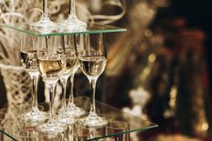Elegant champagne glasses catering, tiered alcohol drinks on glass table, business dinner party reception in luxury restaurant cl. Ose-up, catering concept stock photos