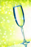 Champagne glasses on the green background Stock Photography