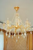 Elegant chandelier glass. In the living room Stock Photos