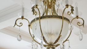 Elegant chandelier hanging under the ceiling.  stock video