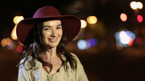 Elegant charming woman smiling in night city stock footage