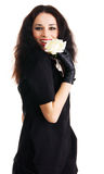 Elegant cheerful brunette with a white rose Stock Photo