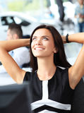 Elegant cheerful woman relaxing in office Stock Image