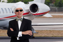 Elegant chef posing in front of a jet Royalty Free Stock Images