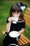 Elegant child girl having a tea party outdoors Royalty Free Stock Photography