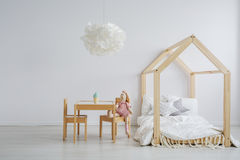 Elegant child table and bed stock photo