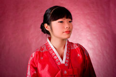 Elegant chinese model in traditional red dress Royalty Free Stock Photo
