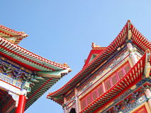 Elegant Chinese temple. On the blue sky Stock Photos