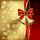 Elegant Christmas background with golden bells Stock Photos