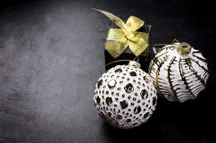 Elegant Christmas background with white retro balls and gifts royalty free stock photos