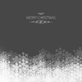 Elegant Christmas card. With snowflakes on a grey background Stock Photography
