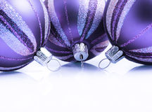 Elegant Christmas Card. Elegant Baubles in purple with soft reflection Royalty Free Stock Photo