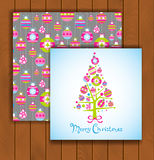 Elegant Christmas card with an envelope. Stylish pine tree made of decorative Christmas balls Stock Photos
