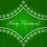 Elegant christmas card. With pattern and snowflakes on green background Stock Photo
