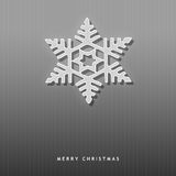 Elegant Christmas card with a snowflake. Elegant Christmas card with a simple snowflake on a grey background Royalty Free Stock Images