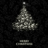 Elegant Christmas card with a symbolic tree. On a vintage background Royalty Free Stock Photo