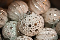 Rustic white and golden Christmas baubles Royalty Free Stock Photo