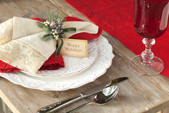 Elegant Christmas dining scene on rustic wood table Stock Photography