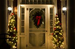 Elegant Christmas Doorway at Night. Night view of a the main door to a lovely Victorian mansion, decorated for the Christmas holidays in Cape May, New Jersey Royalty Free Stock Photo