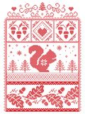 Elegant Christmas Scandinavian, Nordic style winter stitching, pattern including snowflake, heart, squirrel, acorn, oak leaf Royalty Free Stock Photo