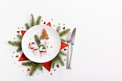 Free Elegant Christmas Table Setting Design Captured From Above Top View, Flat Lay. Empty White Plate, Glass, Cutlery, Candy Royalty Free Stock Photos - 134629338