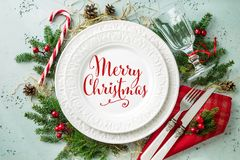 Elegant christmas table setting design top view, flat lay. Elegant christmas table setting design captured from above top view, flat lay. White plate with red ` stock photography