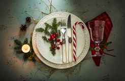 Elegant christmas table setting design top view, flat lay. Elegant christmas table setting design captured from above top view, flat lay. White plates, glass royalty free stock images