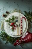 Elegant christmas table setting design top view, flat lay. Elegant christmas table setting design captured from above top view, flat lay. White plates, glass stock photos