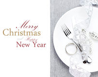 Elegant Christmas table setting with festive decorations on whit Royalty Free Stock Photo
