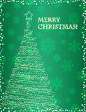 Elegant christmas tree on the green background Stock Photos