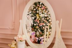 Elegant Christmas tree reflected in the mirror stock photos