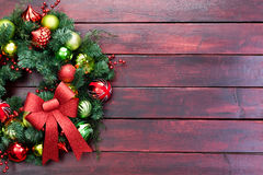 Elegant Christmas wreath with baubles and bow Stock Photos
