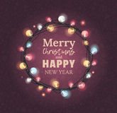 Elegant Christmas wreath with lettteringom Merry  and Happy New Year. Royalty Free Stock Photo