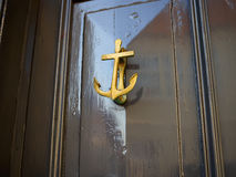 Elegant classical door knocker shaped as an anchor Royalty Free Stock Photo