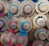 Colorful muticolored hats for sale at the street walk on summer royalty free stock images