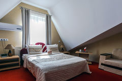 Elegant and comfortable interior of a bedroom in hotel Stock Image