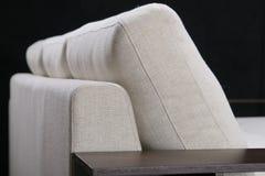 Elegant comfortable sofa. On black Stock Image