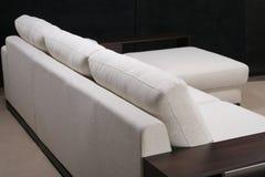 Elegant comfortable sofa. On black Stock Photography