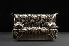 Elegant comfortable sofa. On black Royalty Free Stock Photography