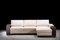Elegant comfortable sofa. On black Royalty Free Stock Photography