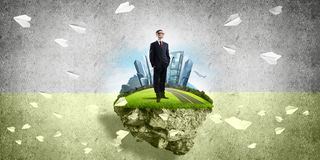 Confident boss and modern city as concept of eco green construction. Elegant confident businessman standing on green floating island against concrete background vector illustration