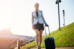 Elegant confident businesswoman on business trip. Front portrait of mature confident businesswoman on business trip Stock Images