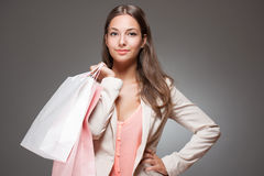 Elegant cool shopping beauty. Stock Photography