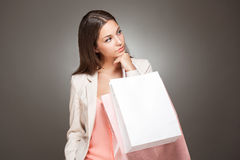 Elegant cool shopping beauty. Royalty Free Stock Photo