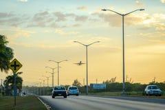 The Elegant Corridor highway in Montego Bay, Jamaica. Montego Bay, Jamaica - April 14 2018: The Elegant Corridor highway in Montego Bay, Jamaica. Aircraft in royalty free stock photography