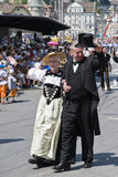 Elegant couple. Walking and waving the crowd during the jodler's parade in Luzern, Switzerland Royalty Free Stock Photos