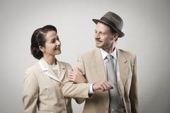 Elegant couple arm in arm. Elegant vintage couple arm in arm, 1950s style Stock Photography