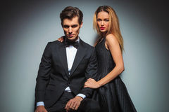 Elegant couple in black posing embraced Royalty Free Stock Photo