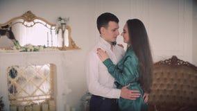 Elegant couple in a classic studio interior stock video