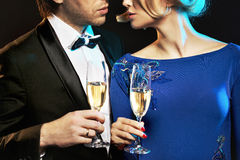 Elegant couple drinking a champagne Royalty Free Stock Image